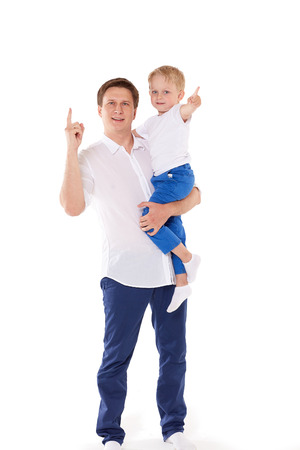 forefinger: Young happy father with sweet child stands on a white background. Happy family.