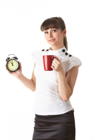 Young businesswoman holds a alarm clock and cup on  a white  background. Lunch time.