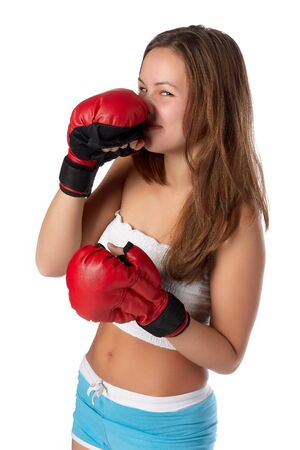 venganza: Sporty girl in red fighting gloves on a white background.