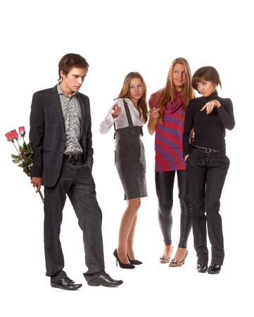 unexpectedness: The young man with a bouquet and group of girls on a white background.