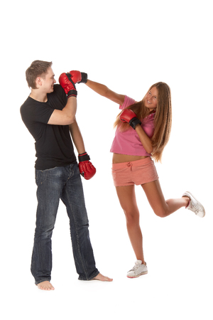 venganza: Sporty couple in red fighting gloves on a white background. Foto de archivo
