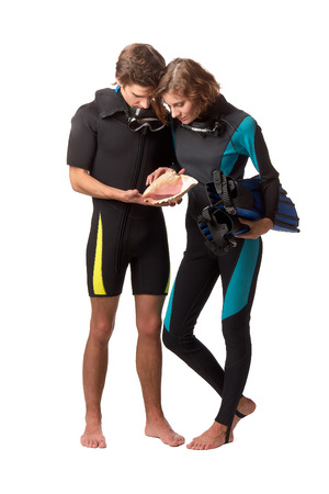 Young happy people with diving suits with a seashell on a white background.