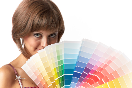 The beautiful girl with a color guide on a white background. photo