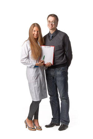 The beautiful  female oculist  with blank clipboard and  patient on a white background. photo