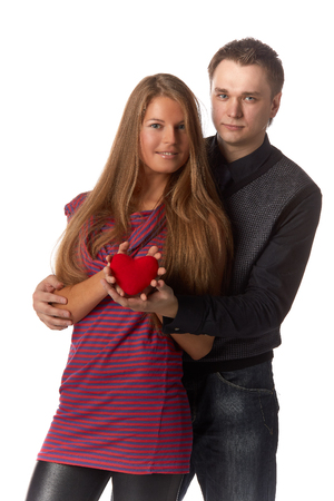 Young enamoured couple with a heart on a white background. photo