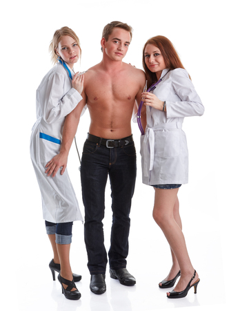 Two nurses and the young male patient on a white background. Vaccination