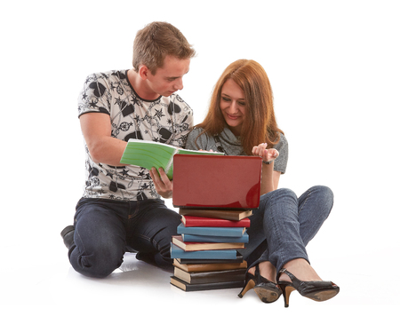 spolužák: Two students prepare for examination on a white background