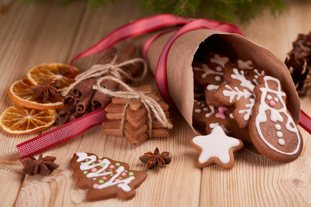 cornet: Christmas gingerbreads. Christmas decorations. Handmade cookies in paper cone  lying on the wooden table.  Christmas and New Year treats.