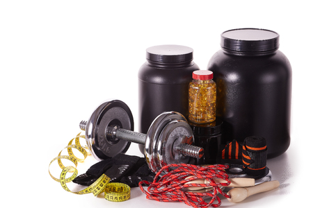 Sports  nutrition (supplements), sport accessories and dumbbells isolated on a white background. Fitness, sport and healthy lifestyle concept.