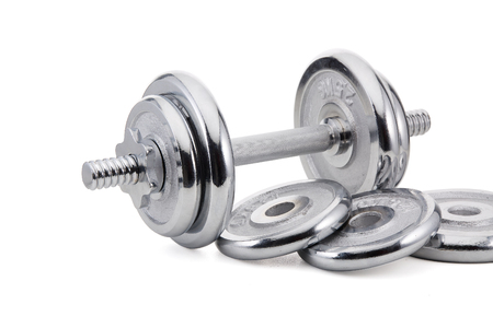 Steel dumbbell and weights on white background. Sports bodybuilding equipment. Fitness, sport or healthy lifestyle concept.