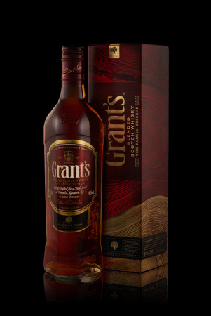 Bottle of Grant's whisky on a black background with reflection. Stock Photo - 110993749