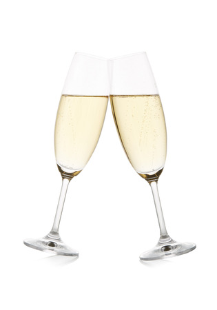 Two wineglasses with champagne isolated on a white background with reflection