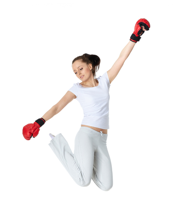 Sporty young woman in red fighting gloves on a white background.
