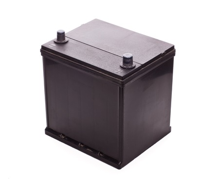 Black car accumulator battery isolated on a white background. Acid battery,12 volts supply Imagens