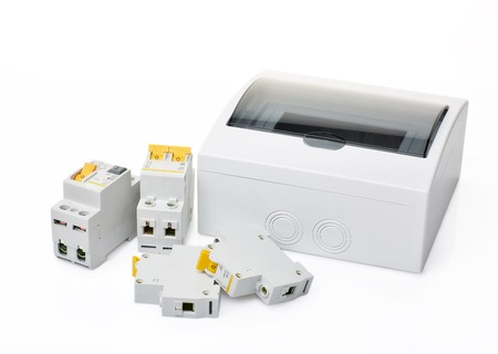Automatic circuit breakers and distribution box on a white background. Electrical equipment. Accessories for protection and control electric. Reklamní fotografie