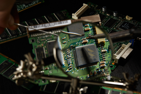 Green Circuit Board Background. Computer technology, abstract backgrounds, engineering, electronics, information technology concept.