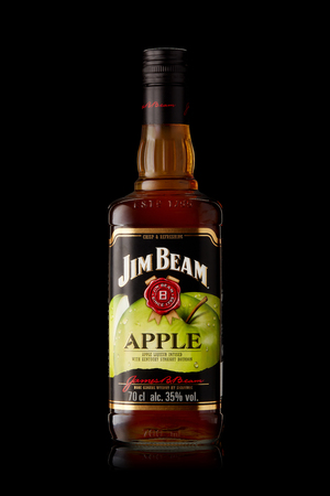 Bottle of Jim Beam Apple (apple liqueur infused with kentucky straight bourbon) on a white background with reflection.