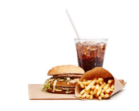 Still life with hamburger,  french fries and glass of sweet fizzy beverage with ices isolated on a white background with copy space Fast food concept.