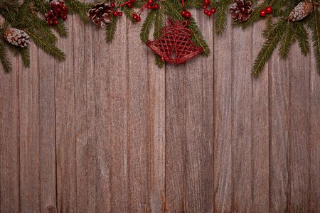 Wooden vintage background with fir tree branches and Christmas ornaments. Top view with copy space. New Year and Christmas, For greeting card or advertising