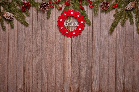 Wooden vintage background with fir tree branches and Christmas ornaments. Top view with copy space. New Year and Christmas, For greeting card or advertising Imagens