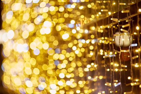 Festive background with LED lights garland. Christmas and New Year background. Blurred bokeh from the lights of a garland. Banco de Imagens