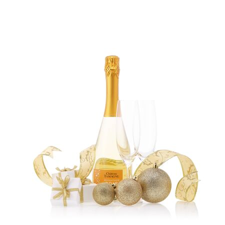 Bottle of muscat white young sparkling wine Chateau Tamagne 2018, gift boxes and Christmas ornaments isolated on a white background. New Year and Christmas