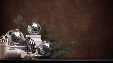 Sports nutrition (supplements), sports equipment, branch of fir,  Christmas ornaments on dark brown background with copy space. Fitness, sport or healthy lifestyle concept. New Year and Christmas. Stock Photo