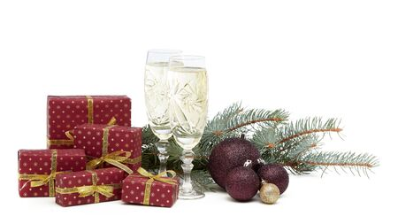 Still life with two champagne flutes, gift boxes and Christmas decoration with fir tree branch isolated on white  background with copy space. Christmas and New Year shopping. Greeting card