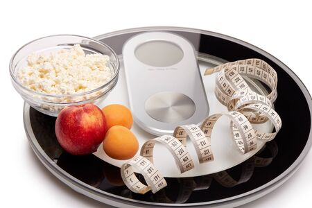 Slimming, diet, and control of weight. Still life with healthy food, scales and measuring tape. Healthy nutrition. Healthy lifestyle concept. Control of weight during the isolation period