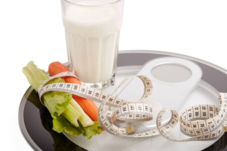 Slimming, diet, and control of weight. Still life with healthy food, scales and measuring tape. Healthy nutrition. Healthy lifestyle concept. Control of weight during the isolation period Archivio Fotografico