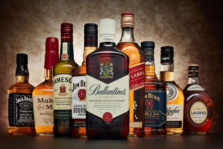 St.Petersburg, Russia - April  2020 - Bottle of Ballantine's Finest blended scotch whisky on background of other popular brands of whiskey (whisky) on dark  background