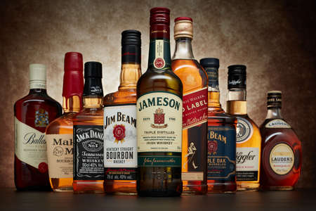 St.Petersburg, Russia - April  2020 - Bottle of Jameson irish whiskey on background of other popular brands of whiskey (whisky) on dark  background