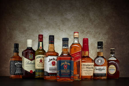 St.Petersburg, Russia - April  2020 - Bottles of several most popular whiskey (whisky) brands on dark  background with copy space.