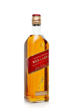 St.Petersburg, Russia - April  2020 - Bottle of Johnnie Walker Red Lebel blended scotch whisky isolated on white background. 新闻类图片
