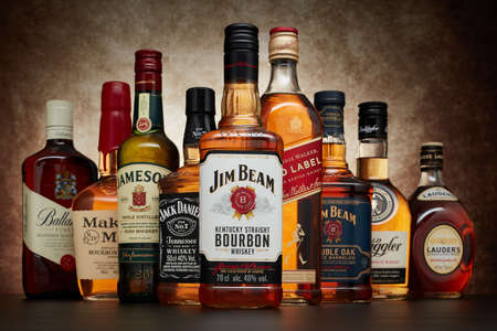 St.Petersburg, Russia - April  2020 - Bottle of Jim Beam bourbon whiskey  on background of other popular brands of whiskey (whisky) on dark  background