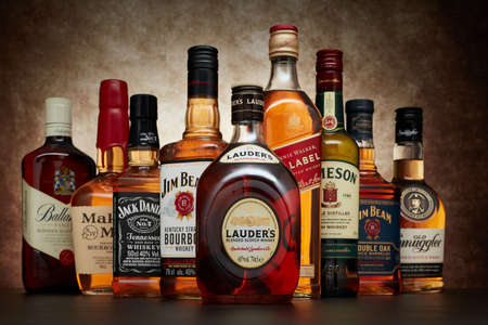 St.Petersburg, Russia - April  2020 - Bottle of Lauder's blended scotch whisky on background of other popular brands of whiskey (whisky) on dark  background