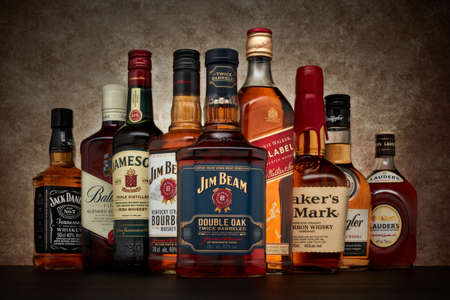 St.Petersburg, Russia - April  2020 - Bottle of Jim Beam bourbon whiskey (double oak twice barreled) on background of other popular brands of whiskey (whisky) on dark  background