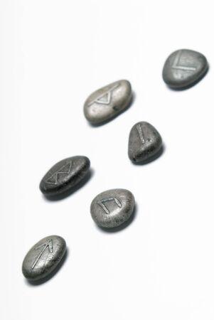 Viking runes on a white background. Limited DOF. photo