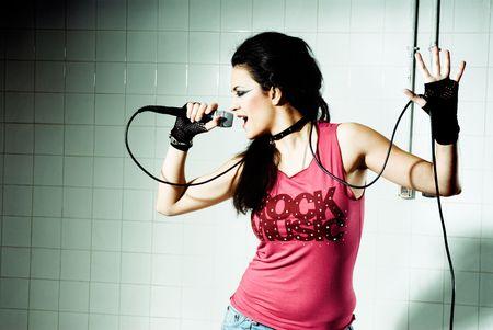 Punk Girl singing on an underground background photo