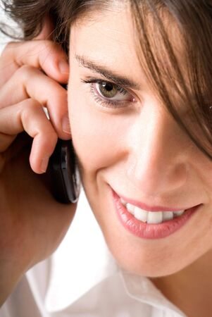 Young woman talking by telephone and smiling Stock Photo