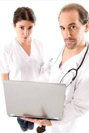Adult doctor and young nurse with laptop on white backgrund,  photo