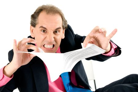 hardworker: Angry businessman breaking contract on white background.  Stock Photo