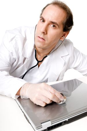 Doctor with stethoscope fixing laptop, good technical support symbol.