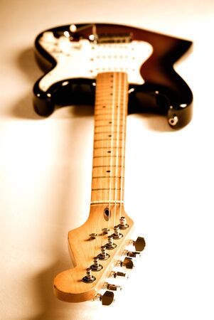 Electric guitar with orange lighting and shallow depth of field.   photo