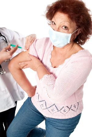 Senior woman getting flu vaccine on white background. photo