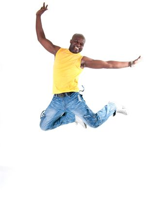 Black strong man jumping on white background.