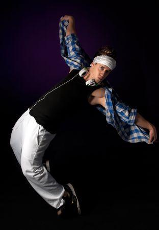 Young hip-hop dancer performing acrobatics.  photo