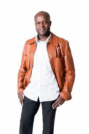 Handsome black man with leather jacket smiling isolated on white background.  Stock Photo