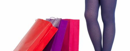 Shopping bags and woman legs wearing panties isolated on white background. Shopping concept. photo
