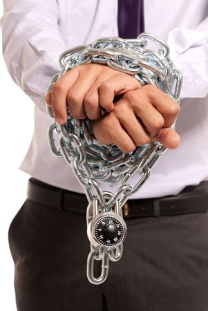 Businessman hands fettered with chain and padlock, job slave symbol, isolated on white background Stock Photo - 7362126